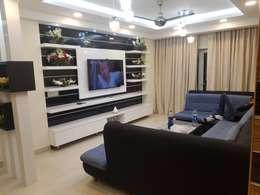 Jain's residency: modern Living room by Fabros Interiors