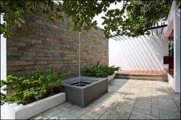 water feature: minimalistic Garden by Land Design landscape architects