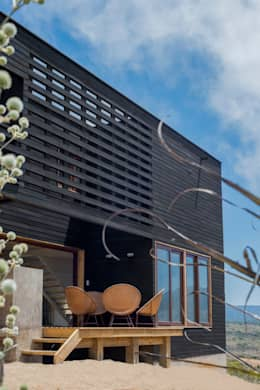 Casas de estilo rústico por Thomas Löwenstein arquitecto