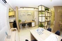 Estudios y despachos de estilo industrial por Jorge Machado arquitetura