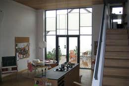 moderne Woonkamer door mhp | Architekten Innenarchitekten