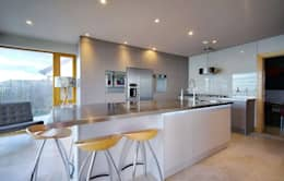 Large Island and Appliance Wall: modern Kitchen by ADORNAS KITCHENS
