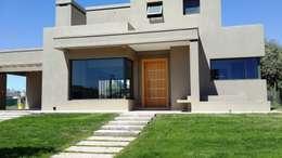 CASA BARRIO RINCON DE TERRADA. DRUMMOND. MENDOZA: Casas de estilo moderno por CIVIT & GUTIERREZ  - arquitectura