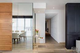 16MAN: Pasillos y recibidores de estilo  por NIVEL TRES ARQUITECTURA