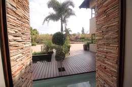 House Swaziland: modern Garden by Principia Design