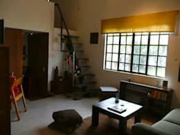 Casa de campo en Villas de Galindo: Salas de estilo ecléctico por Alberto M. Saavedra