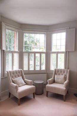 Living Room Shutters For Bay Windows: Modern Living Room By Plantation  Shutters Ltd