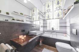 Banheiros modernos por MODO Architettura