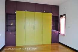 Wardrobe in kids room: minimalistic Nursery/kid's room by Aadyam Design Studio