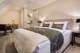Спальни в . Автор – Home Staging Sylt GmbH