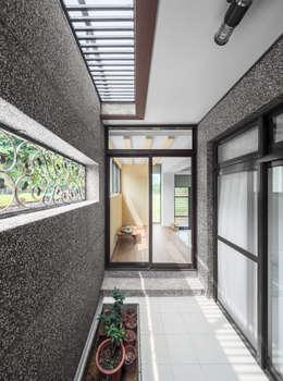 Glocal Architecture Office (G.A.O) 吳宗憲建築師事務所/安藤國際室內裝修工程有限公司의 베란다