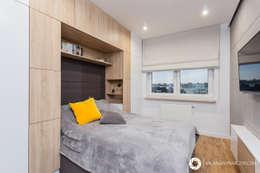 Dormitorios de estilo moderno por Michał Młynarczyk Fotograf Wnętrz