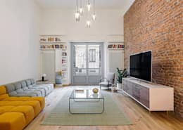 Salas / recibidores de estilo industrial por NOMADE ARCHITETTURA E INTERIOR DESIGN