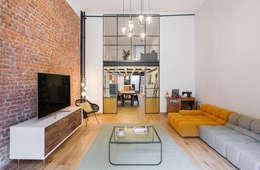 Livings de estilo industrial por NOMADE ARCHITETTURA E INTERIOR DESIGN