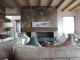 Salas de estilo moderno por David y Letelier Estudio de Arquitectura Ltda.