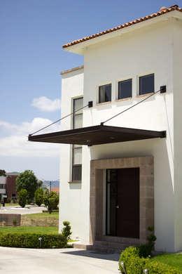 Projekty, nowoczesne Domy zaprojektowane przez Arq. Beatriz Gómez G.