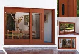 Puerta Corrediza: Puertas y ventanas de estilo moderno por Lens Puertas de Aluminio.