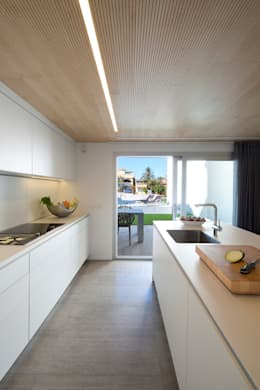 Cozinhas minimalistas por HD Arquitectura d'interiors