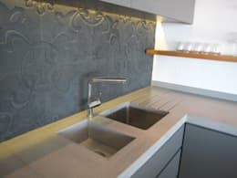 Combines stainless and integrated concrete sink: modern Kitchen by Stoneform Concrete Studios