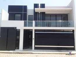 Casa 102: Casas de estilo minimalista por Estudio Chipotle