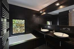 Baños de estilo mediterraneo por Atelier Jean GOUZY