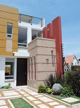 Casas de estilo moderno de DG ARQUITECTURA COLOMBIA