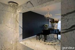 Villas: modern Living room by Grandeur Interiors