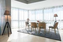 Livings de estilo moderno por eM diseño de interiores