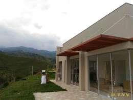 Una Casa de descanso : Casas de estilo moderno por Muros y Casas S.A.S