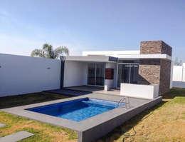 Exterior : Casas de estilo moderno por EBA Architecture & Desing
