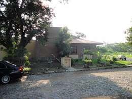 Casas de estilo rural por ARQUITECTOS BARRERA OSORIO