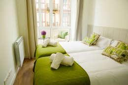 dormitorio:  de estilo  de GLOBALITEDECOSTUDIO