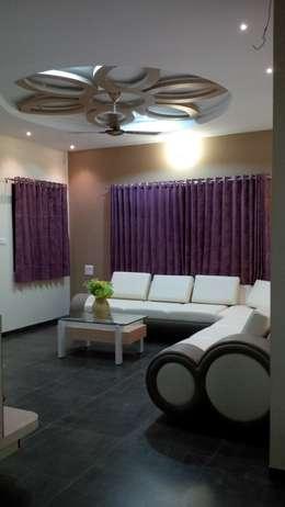 Mansi Twins: modern Living room by AOM Interior