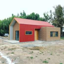 Projekty, industrialne Domy zaprojektowane przez Estudioeco21