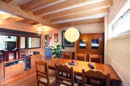 rustic Dining room by Rusticasa