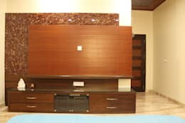 TV cabinet for younger son's bedroom: modern Bedroom by SA Architects
