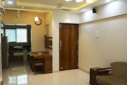 Dining area and hallway entrance: modern Dining room by Vinayak Interior | Interior Designing and Decorator Companies
