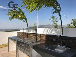 Area Asador: Terrazas de estilo  por GF ARQUITECTOS