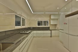SKY DECK: asian Kitchen by SPACCE INTERIORS
