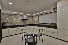 CAPITAL GREEN - 1: asian Kitchen by SPACCE INTERIORS