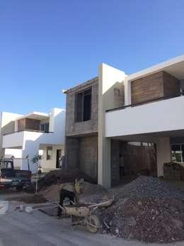 Casas de estilo moderno por Arquitectura-Construcciòn Godwin