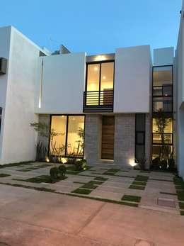 Fachada Principal Atardecer: Casas de estilo moderno por Alfagrama estudio
