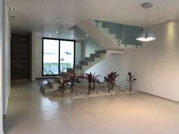Comedor hacia escalera y sala: Comedores de estilo moderno por Alfagrama estudio