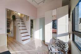 走廊區域:  更衣室 by 一葉藍朵設計家飾所 A Lentil Design