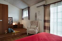 刻意架高的地坪是為了界定另外一個活動空間,讓偌大的空間不會單調,也增加孩童活動的區域:  臥室 by 弘悅國際室內裝修有限公司