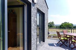Terrazas de estilo  por Casas Cube