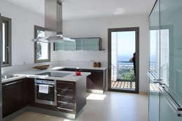 Cocinas de estilo minimalista por HABITANTE