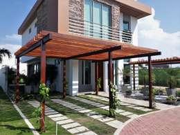 Casa modelo Cerdeña - Novaterra Ocean City: Jardines de estilo tropical por ecoexteriores