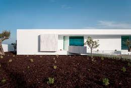Casa Carrara Entrada: Habitações  por Tendenza -  Interior Design