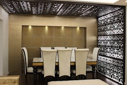 Living room design with MDF jaali design on wall and ceiling : modern Living room by Prodigy Designs